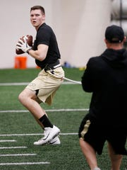 Junior quarterback Elijah Sindelar works out under the watchful eye of Domenic Reno, senior associate director of football strength and conditioning, during Purdue spring football practice Monday, April 2, 2018, inside the Mollenkopf Athletic Center.