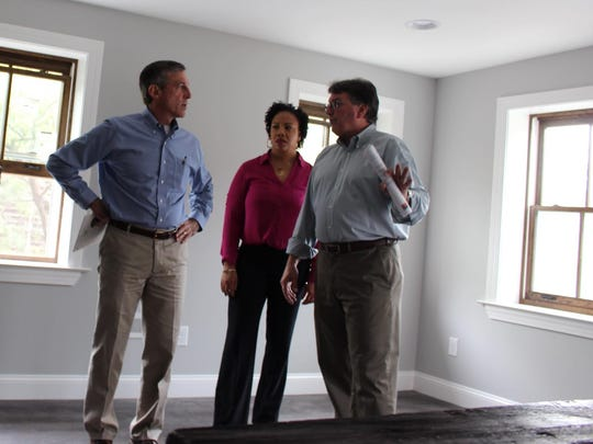 Gov. John Carney meets with Interfaith Housing's HomeWorks Program Manager Danielle Brothers and Executive Director Gary Pollio (right) during a tour of their property in October 2017.