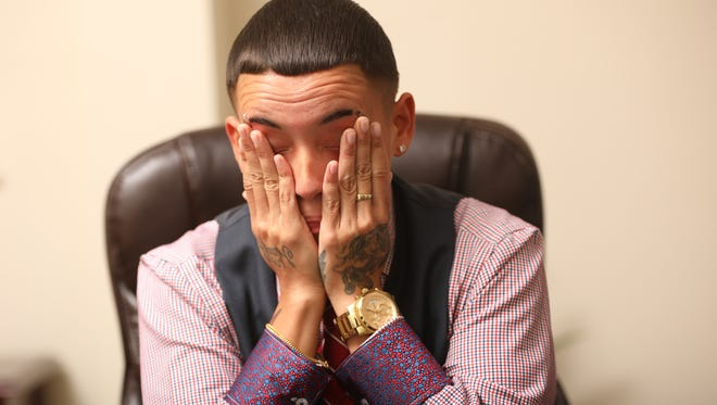 Nautica Pagan, 33, of Clifton gets emotional when talking about his ordeal at a Paterson grocery store. Pagan, shown in the Morristown law office of Castronovo & McKinney, talked to The Record about what happened at Food Fair La Gran Marqueta in Paterson. While at the grocery store earlier this summer, Pagan, who identifies as a transgender man, was accused of shoplifting and was allegedly forced to show his prosthetic penis.  Pagan is now suing.  Monday, September 18, 2017.