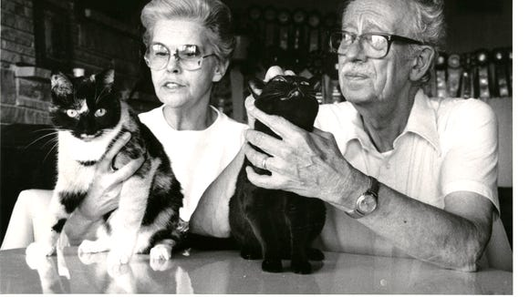Cliff and Wini Keuler rub their cats in their home near Kimberling City in July 0f 1991.