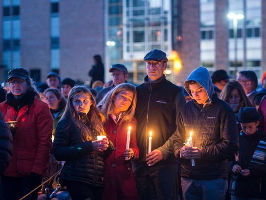 Community members gather for a vigil for five high