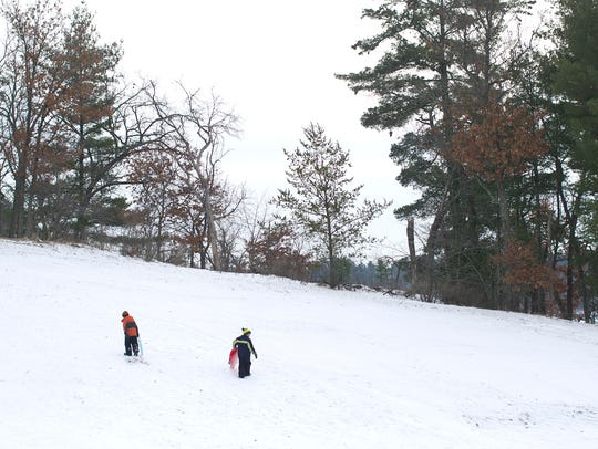 Sledding at Nepco Lake County Park in Wisconsin Rapids