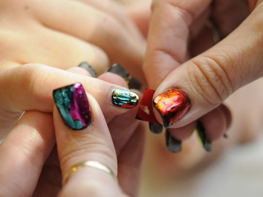 Nail Technician shows how to do nails four different ways in the salon.