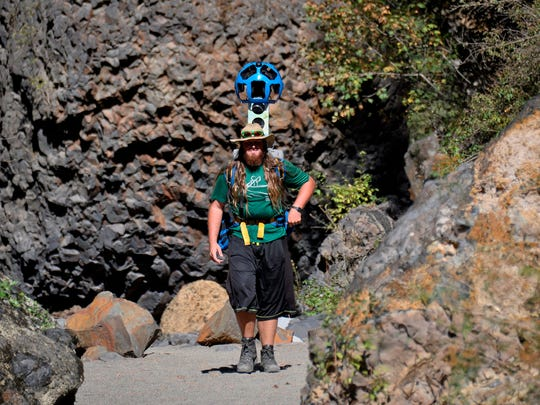 Volunteer Andy Fuzak hikes up Deep Creek Canyon with the Google Trekker camera system to record a route in Riverside State Park for the public to view online.