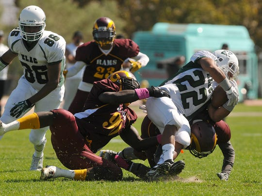Dougladson Subtyl (90) makes a tackle for Victor Valley Community College.