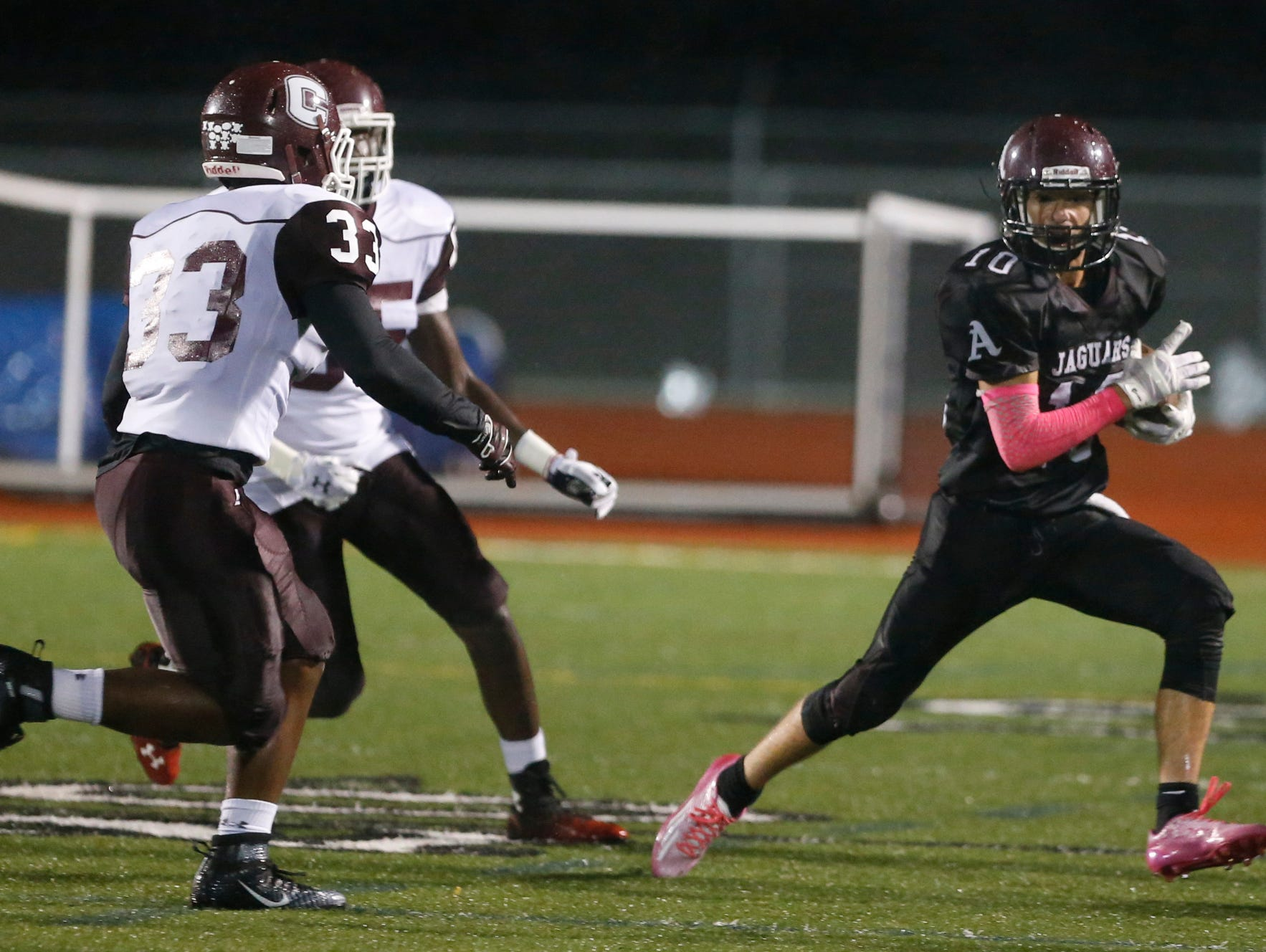 Appoquinimink's Kevin Banning (right), shown here against Concord's Byron Simpson (33), returned a kickoff for a TD in the Jaguars' wild win at A.I. du Pont.