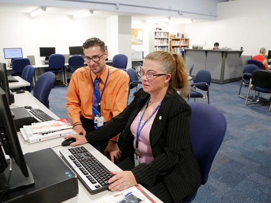 Students Amber Myers and Jake Foulks work in the open concept library at the new home of Harrison College Tuesday, July 19, 2016, at 323 Columbia Street in downtown Lafayette. Myers is pursuing a bachelor degree in health care management while Foulks is working to earn a bachelor in hospitality management. Foulks said he loves the new location downtown as it is within walking distance from where he lives.
