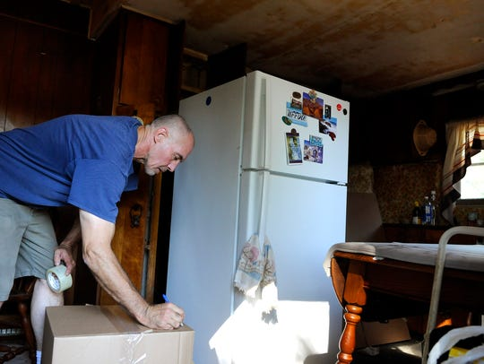 Wayne Aronson of Granite City Moving packs and labels