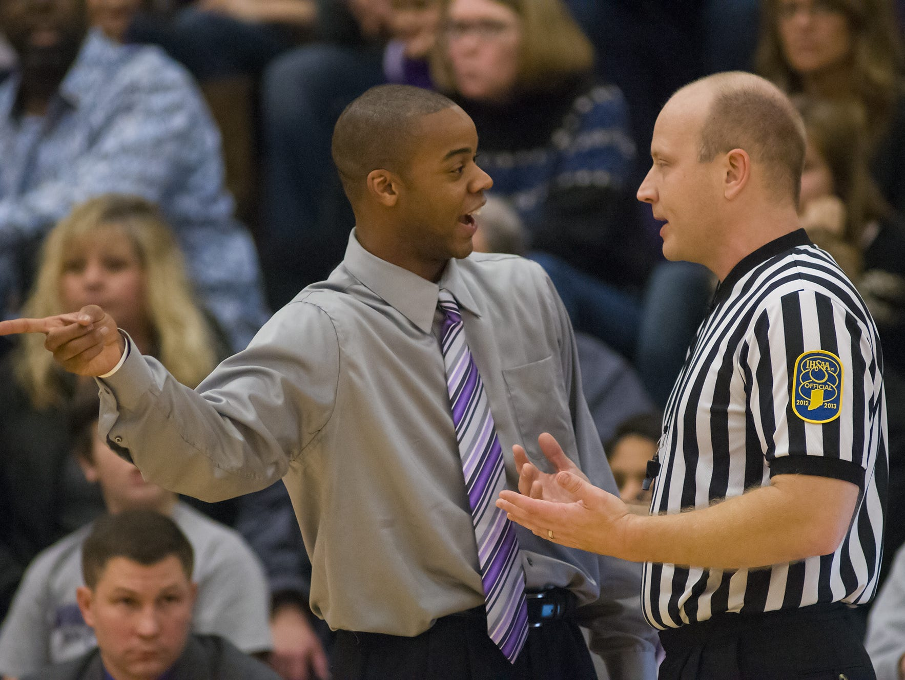 FILE -- Brownsburg High School's head coach, Ronald Nored, questions an official during a break in the action. Dec. 5, 2013. He currently coaches the Brooklyn Nets' D-League affiliate.