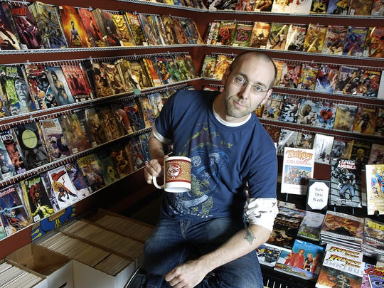 Matt Johnson, 34, co-owner of Cup-O-Kryptonite in Des Moines has been running a comic book and coffee shop for six years.