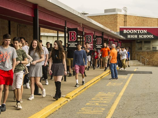 Boonton High School students walk out of the auditorium