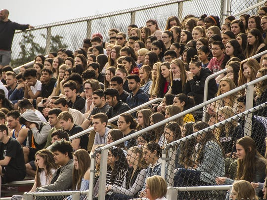 Students pack the football stands during the anti-gun