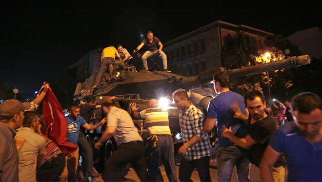Tanks move into position as Turkish people attempt to stop them, in Ankara, Turkey, July 15, 2016.