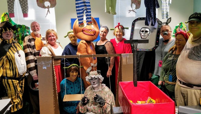"The City of Alamogordo celebrated Halloween by decorating their departments in different themes. The Finance Department dressed up as characters from ""Shrek."""