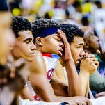 The Everett bench reacts as time expires in their Class A state semifinal loss to Saginaw Arthur Hill Friday March 27, 2015 at the Breslin Center in East Lansing.