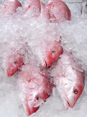 FILE - In this Nov. 30, 2005, file photo, a few whole red snapper are shown for sale at Joe Patti's Seafood Market in Pensacola, Fla. Two environmental groups have sued the federal government for stretching the red snapper season for recreational anglers while acknowledging that could add years to the species' recovery from nearly disastrous overfishing. (AP Photo/Mari Darr~Welch, File)