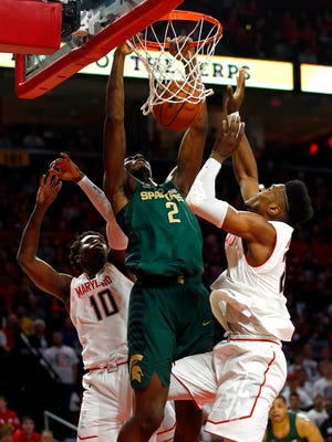 Michigan State forward Jaren Jackson Jr. (2) dunks against Maryland guard Darryl Morsell (10) and forward Bruno Fernando, of Angola, in the first half of an NCAA college basketball game in College Park, Md., Sunday, Jan. 28, 2018.