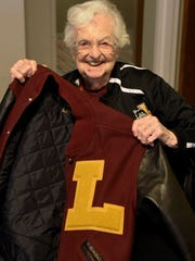 Sister Jean Dolores Schmidt, the chaplain of the Loyola men's basketball team shows offer her letterman's jack. The Ramblers made the Sweet 16 and will face Nevada in Atlanta in the NCAA tournament.