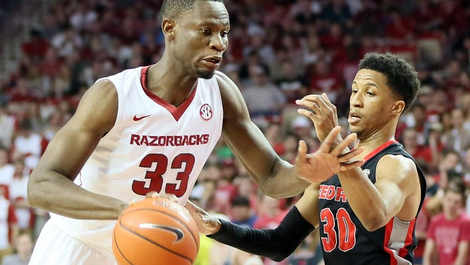 Arkansas forward Moses Kingsley (33) drives against Georgia guard J.J. Frazier (30) on March 4.