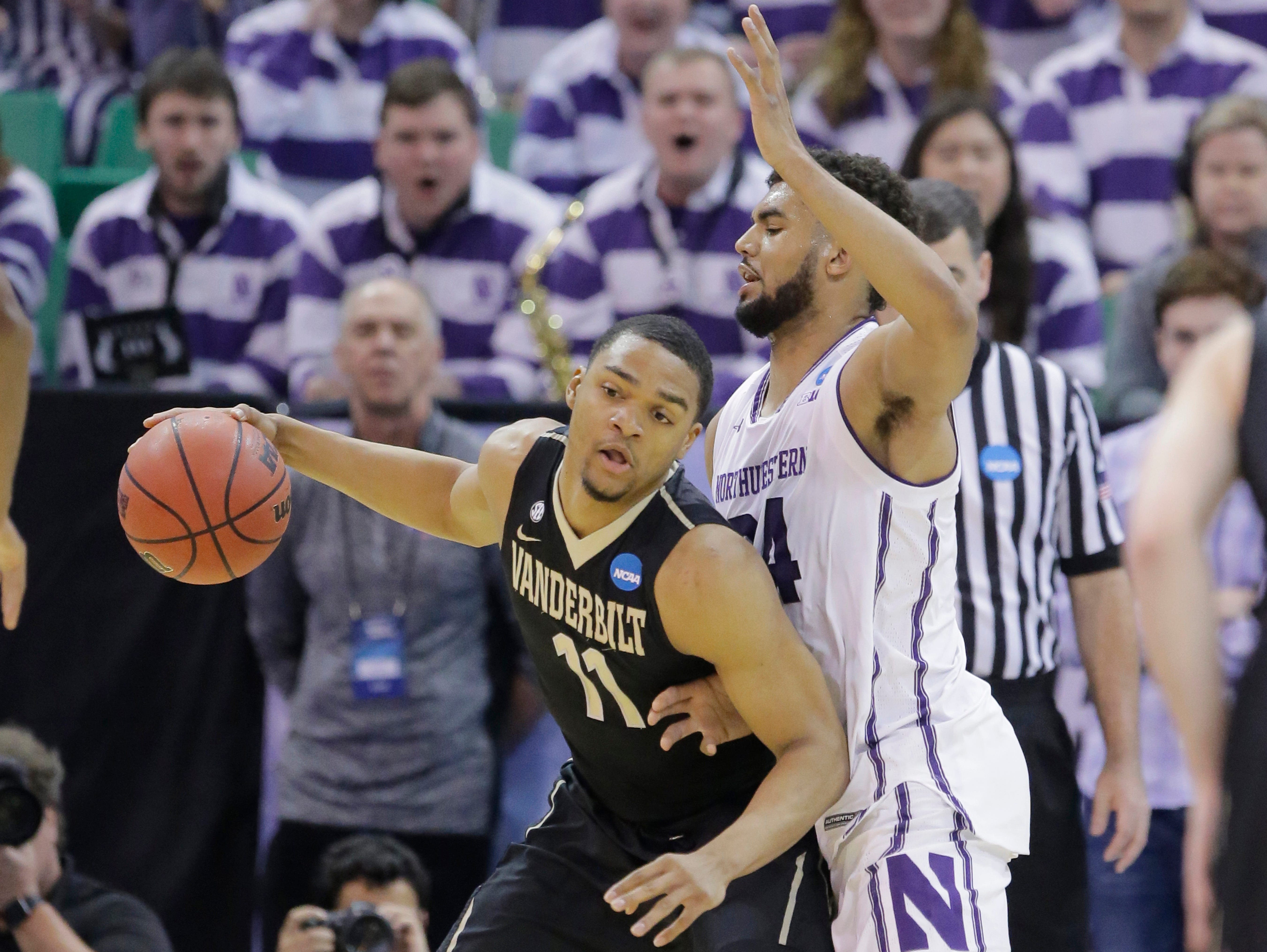 Northwestern guard Sanjay Lumpkin guards Vanderbilt forward Jeff Roberson (11) during the first half of an NCAA Tournament first-round game on March 16, 2017, in Salt Lake City.