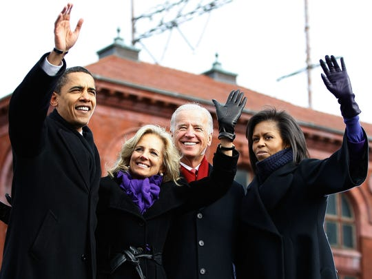 President-elect Barack Obama, Jill Biden, Vice President-elect Joe Biden and Michelle Obama wave to a crowd of supporters during a rally outside the train station on January 17, 2009 in Wilmington.