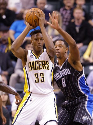 Orlando Magic forward Channing Frye (8) defends Indiana Pacers forward Myles Turner (33) during the first half of an NBA basketball game in Indianapolis, Monday, Nov. 9, 2015. (AP Photo/Michael Conroy)