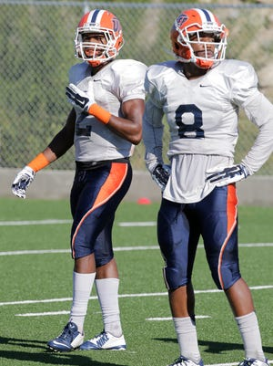 Defensive backs Ishmael Harrison, left, and Kelvin Fisher Jr., right, will be tested by Incarnate Word on Saturday.