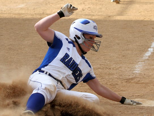 Jessica Rutherford slides home with the winning run