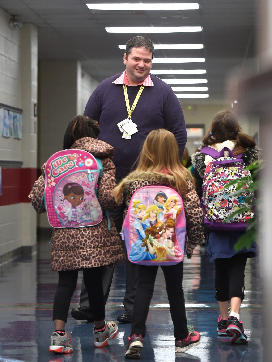 Amqui Elementary School Principal Lance High hugs a student Feb. 16, 2017. High was appointed Amqui's principal for the 2015-16 school year. He now works at Smith Springs Elementary School in South Nashville.