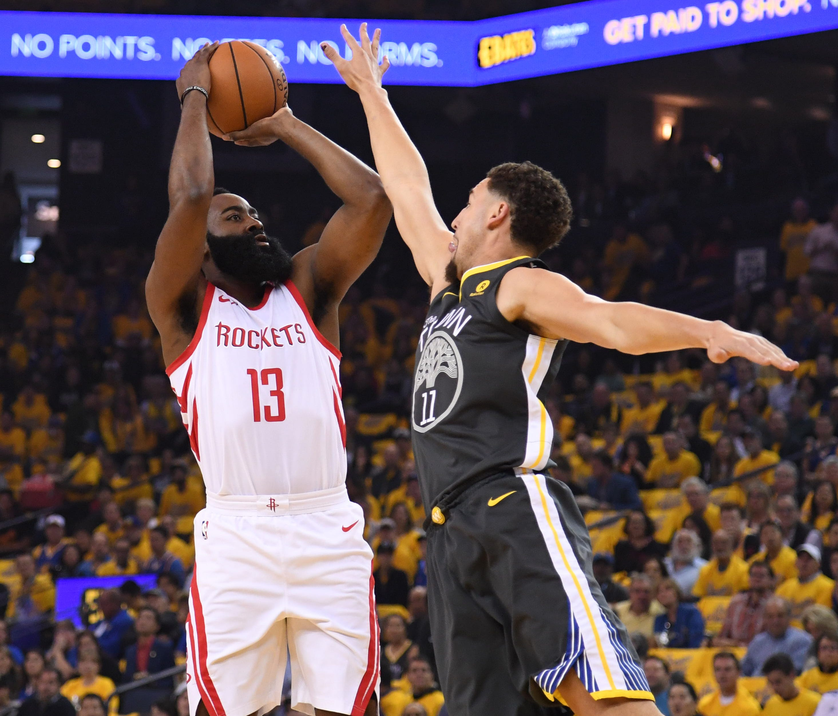 Houston Rockets guard James Harden shoots over Golden State Warriors guard Klay Thompson during the first quarter of Game 4.