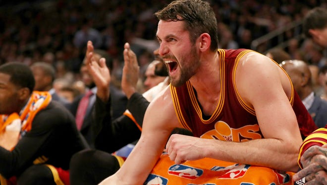 Kevin Love #0 of the Cleveland Cavaliers celebrates from the bench  in the second quarter against the New York Knicks  at Madison Square Garden on December 7, 2016 in New York City.