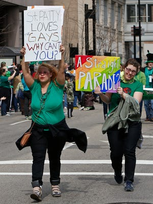 Corinna Young and Sara Crandall were among several gay-rights activists who crashed Cincinnati's St. Patrick's Day Parade in 2013, making their way down most of the parade route, after the local chapter of the Gay Lesbian & Straight Education Network had been denied an official spot on the roster.