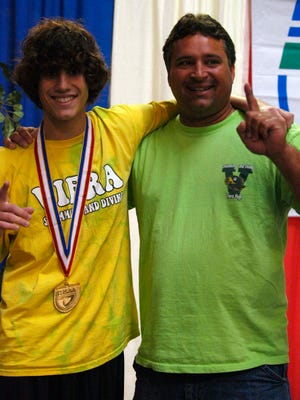 Luke Zippi ranked number one diver in the state of Florida stands next to his diving coach Greg Servaites after his win at the 2009 FHSAA Swimming and Diving Finals. (William H. Skanes II, for FLORIDA TODAY) ( Prep Sports )