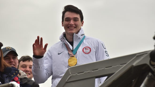 Jack Wallace, a member of the 2018 Paralympic Gold Medal winning men's United States sled hockey team, receives a parade in Franklin Lakes on Tuesday, March 27.