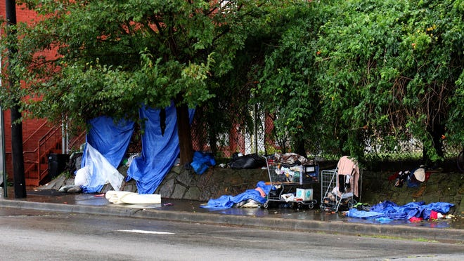 Personal items belonging to area homeless litter the sidewalk along North 'B' Street downtown Fort Smith. After Tuesday morning rain forced the owners to seek shelter from the storm.