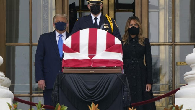 President Donald Trump and first lady Melania Trump pay respects as Justice Ruth Bader Ginsburg lies in repose at the Supreme Court building on Thursday, Sept. 24, 2020, in Washington. Ginsburg, 87, died of cancer on Sept. 18.