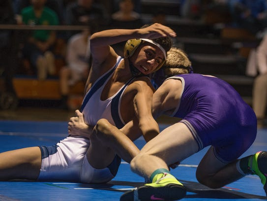 Reno's Ryan Lopez, left, wrestles Spanish Springs Devin