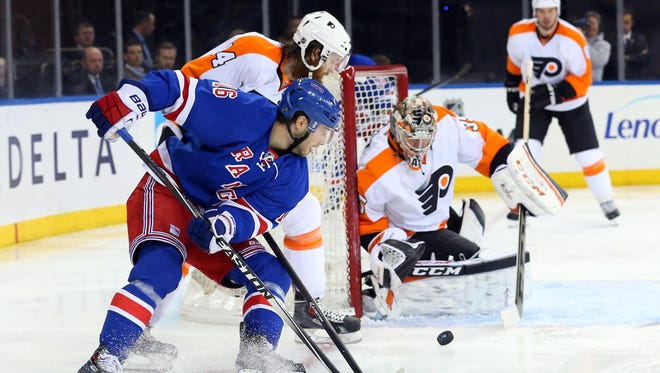 New York Rangers center Derick Brassard (16) shoots on goal during the second period against the Philadelphia Flyers at Madison Square Garden.