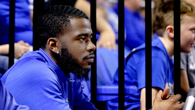 MTSU former player Jacob Ivory watches the men play UAB at home while sitting on an exercise bike on the sidelines on Saturday, Feb. 24, 2018, at MTSU.