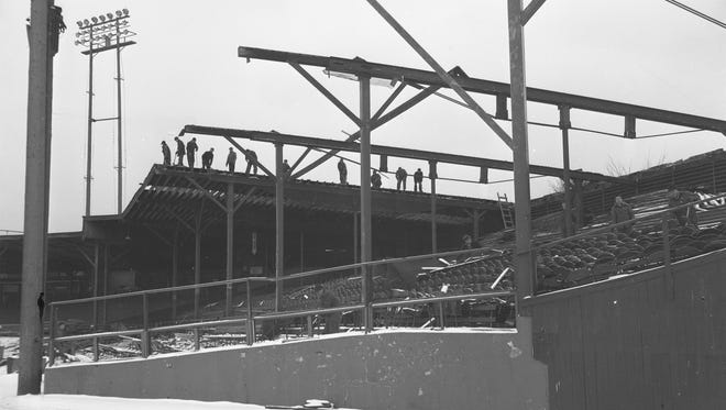 Workers dismantle Borchert Field, Milwaukee's longtime baseball stadium, in this Milwaukee Journal photo, taken on Dec. 30, 1952.