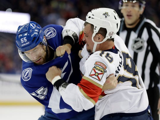 Tampa Bay Lightning defenseman Braydon Coburn (55) and Florida Panthers center Micheal Haley (18) fight during the first period of an NHL hockey game Tuesday, March 6, 2018, in Tampa, Fla. Both players were given five-minute fighting major penalties. (AP Photo/Chris O'Meara)