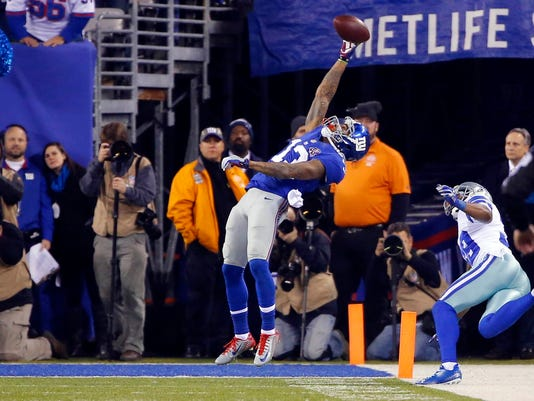 New York Giants wide receiver Beckham pulls in a touchdown pass against the Dallas Cowboys during their NFL football game in East Rutherford, New Jersey