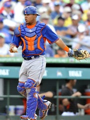 Juan Centeno catches for the New York Mets during a spring training game against the Miami Marlins at Roger Dean Stadium on March 17, 2014.