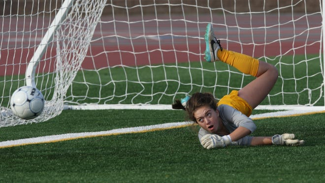 Bernards Township, Watchung Hills goalie Kaylee Donnelly defends during game action against Ridge of the girls soccer North 2 group IV semifinals. Monday Nov. 9, 2015. (Brian Price for The courier News)