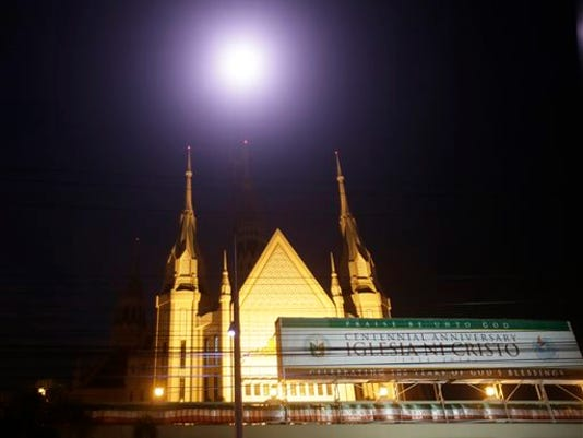 In this photo taken July 23, 2015, the central temple of the Iglesia Ni Cristo or Church of Christ is seen in suburban Quezon city northeast of Manila, Philippines.