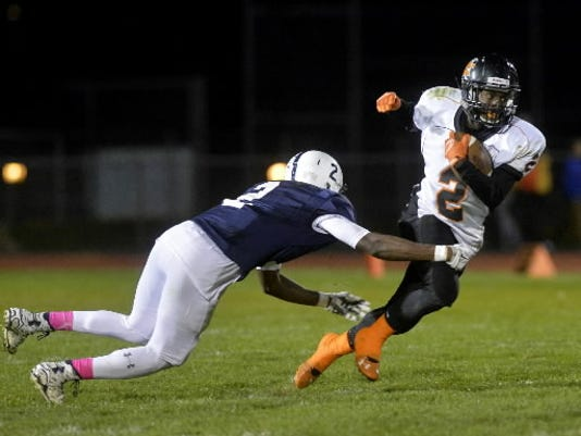 York Suburban s Dajour Henderson rushes in the second half of a YAIAA football game Friday at West York. York Suburban defeated West York 23-22 to move to 3-0 in YAIAA Division II play.