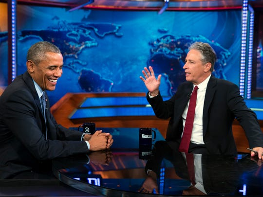 """President Barack Obama talks with Jon Stewart, host of """"The Daily Show"""" during a taping on July 21 in New York. Stewart and his wife on Thursday adopted two horses in Kennett Square, Pennsylvania."""