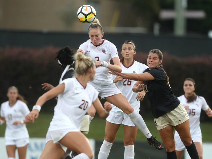 FSU's Megan Connolly heads the ball against Vanderbilt