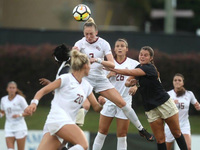 FSU's Megan Connolly heads the ball against Vanderbilt
