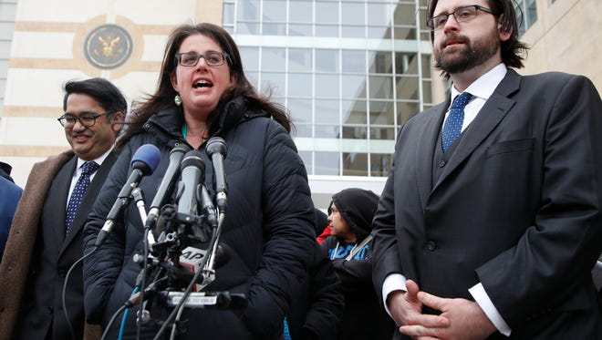 Becca Heller of the International Refugee Assistance Project speaks to reporters outside federal court in Beltsville, Md., on March 15, 2017, about a challenge to President Trump's revised travel ban.